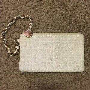 White faux leather wristlet